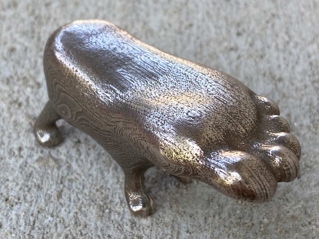 bronze foot with dog legs